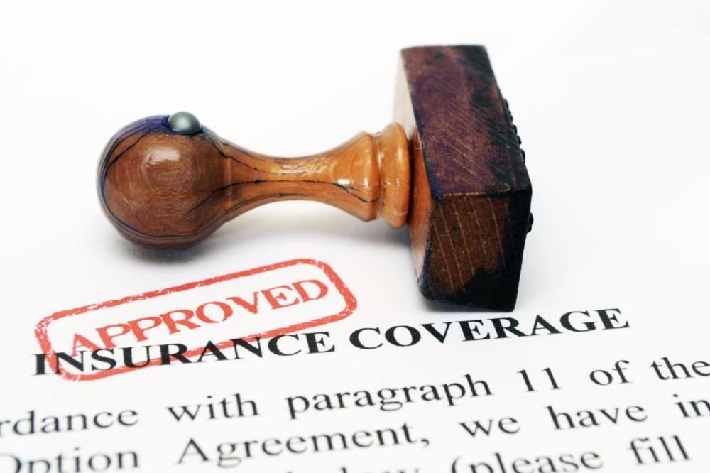 an image of a stamp ontop of insurance papers | Colorado Springs Dentist