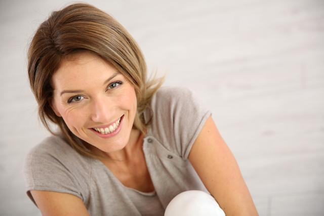 woman sitting down smiling