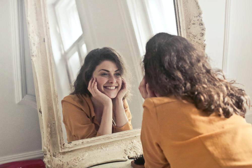 woman smiling in the mirror
