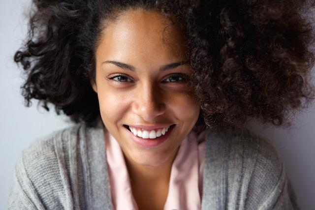 woman with bug curly hair smiling