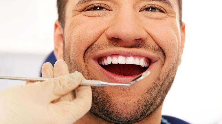 Root Canal in Colorado Springs CO | Man at Dentist
