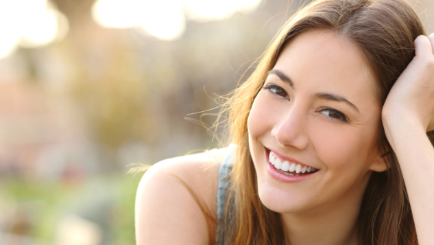 Girl Smiling From Having Dental Bonding | Colorado Springs Dentist