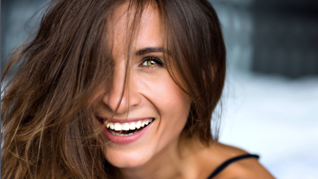 woman with brown hair smiling